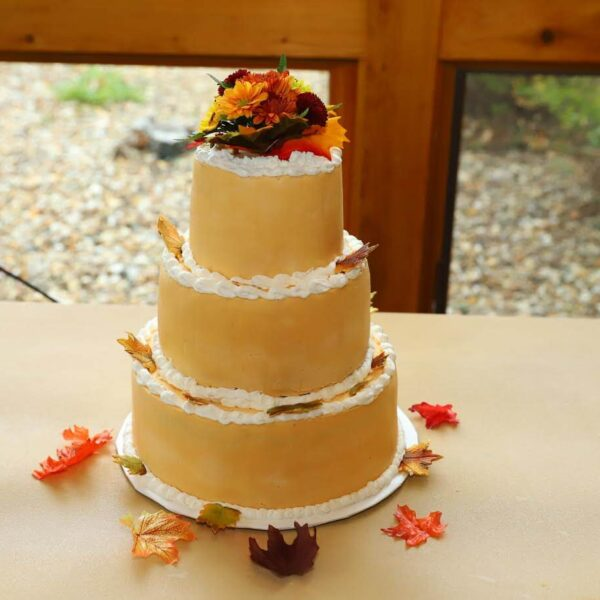Gold and White Frosted 3 Tier Wedding Cake with Leaves Fall Flowers