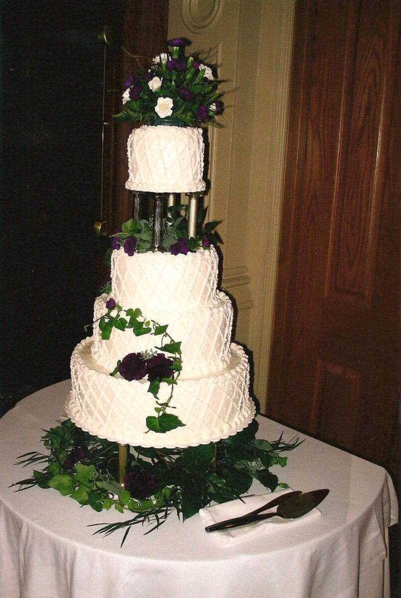 White Frosted 4 Tier Wedding Cake with Flowers and Greenery
