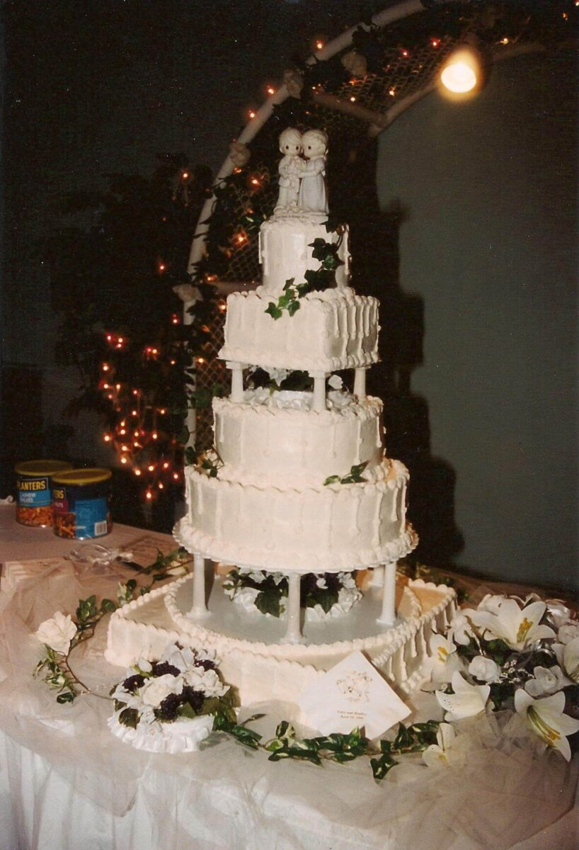 White Frosted 5 Tier Wedding Cake with Flowers