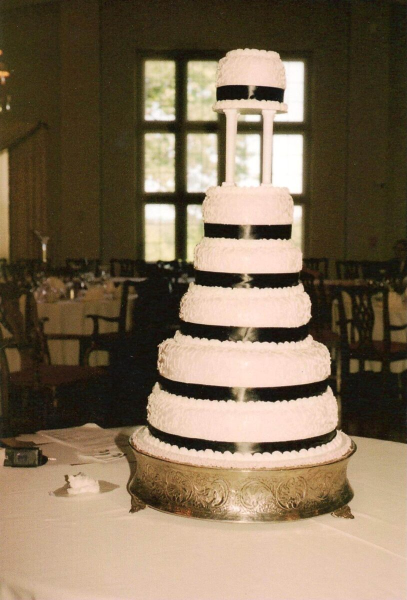 White Frosted 6 Tier Wedding Cake with Black Ribbon