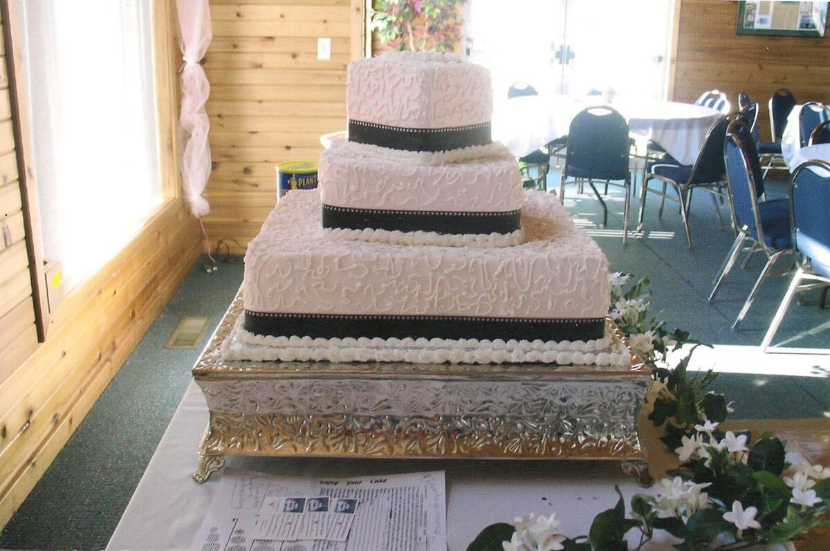 White Frosted 3 Tier Wedding Cake with Black Ribbon