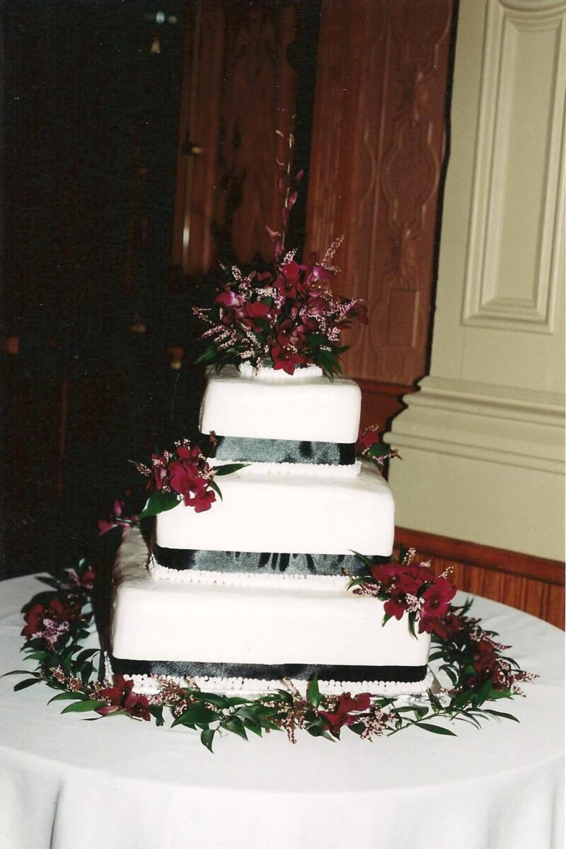 White Frosted 3 Tier Wedding Cake with Black Ribbon and Burgundy Flowers