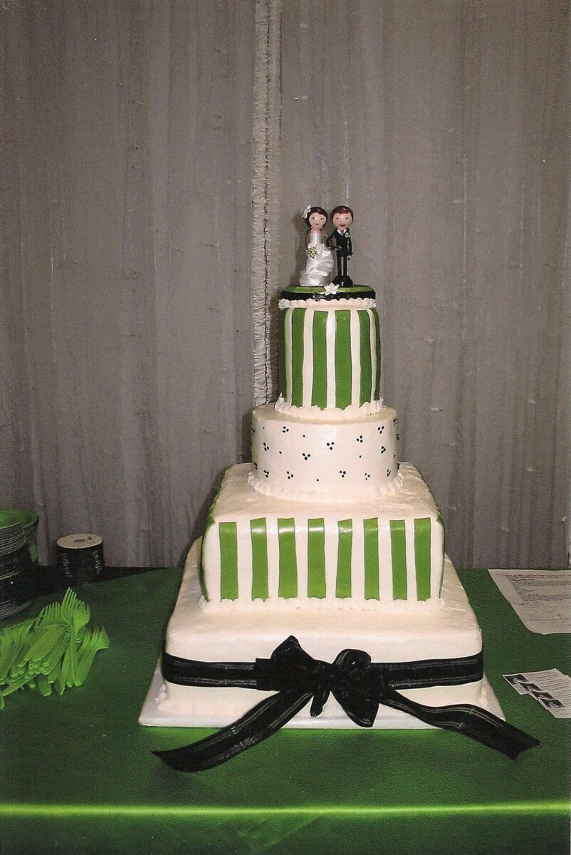 Green & White Frosted 4 Tier Wedding Cake with Black Ribbon