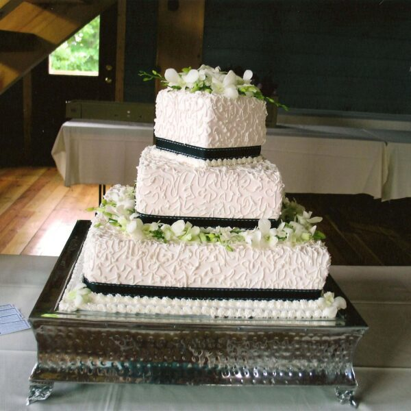 White Frosted 3 Tier Wedding Cake with Black Ribbon and Green and White Flowers
