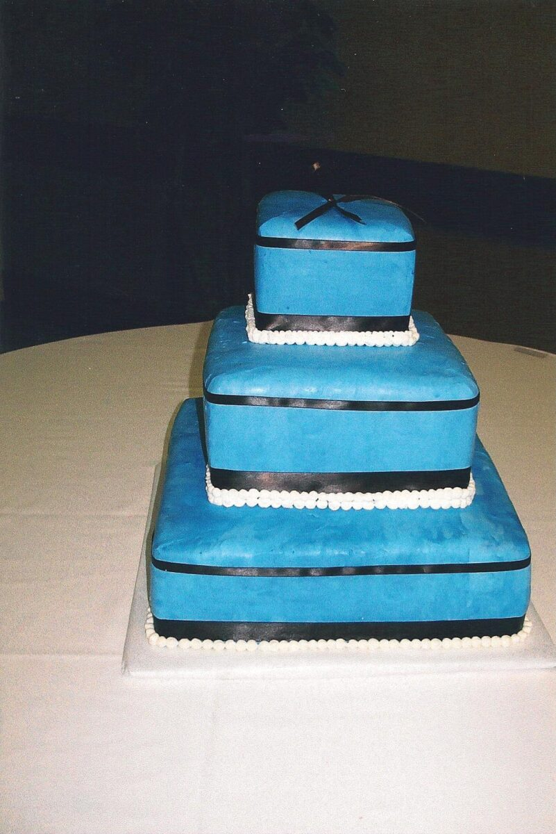 White & Blue Frosted 3 Tier Wedding Cake with Black Ribbon