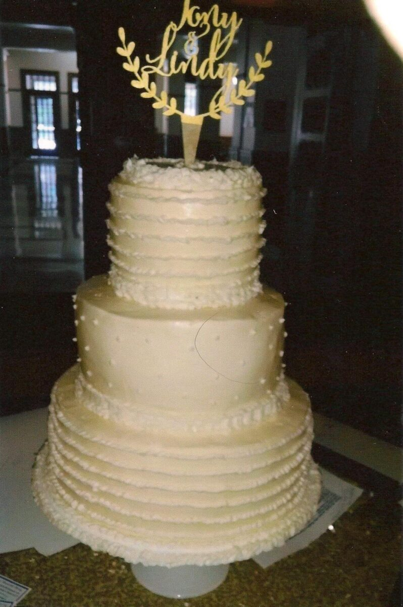 Cream and White Frosted 3 Tier Wedding Cake