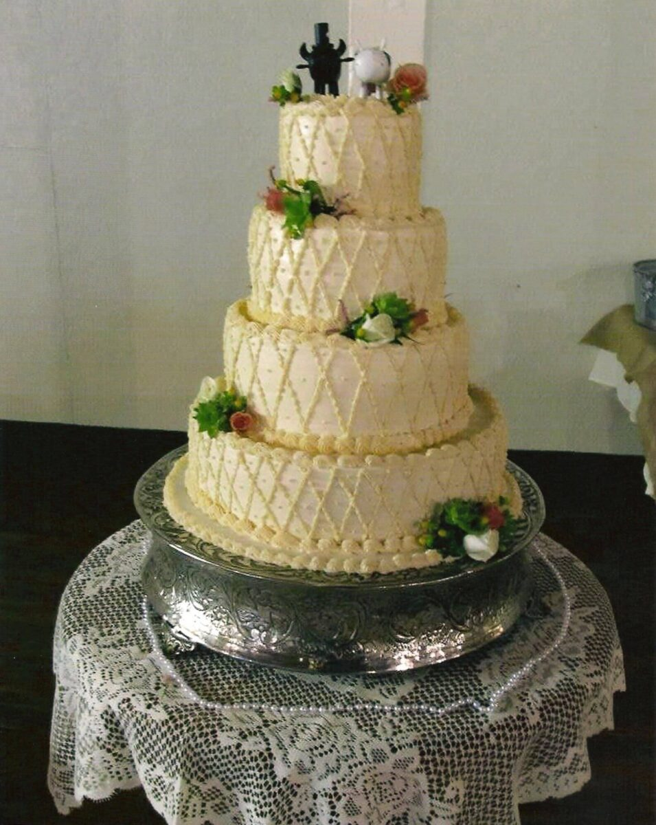 Gold Frosted 4 Tier Wedding Cake with Flowers