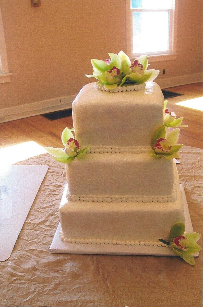 White Frosted 3 Tier Wedding Cake with Green and Pink Flowers