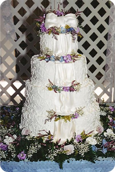 4 Tier Wedding Cake with flowers and ribbon