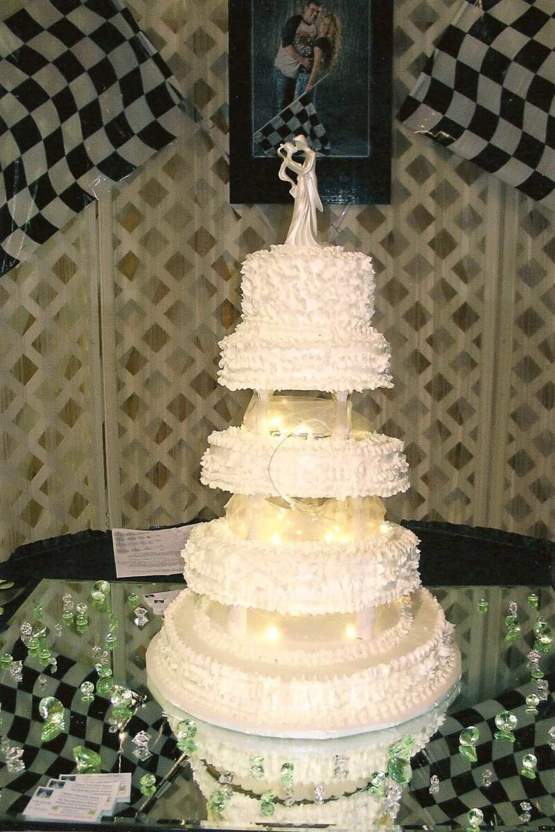 White Frosted 5 Tier Wedding Cake with White Lights