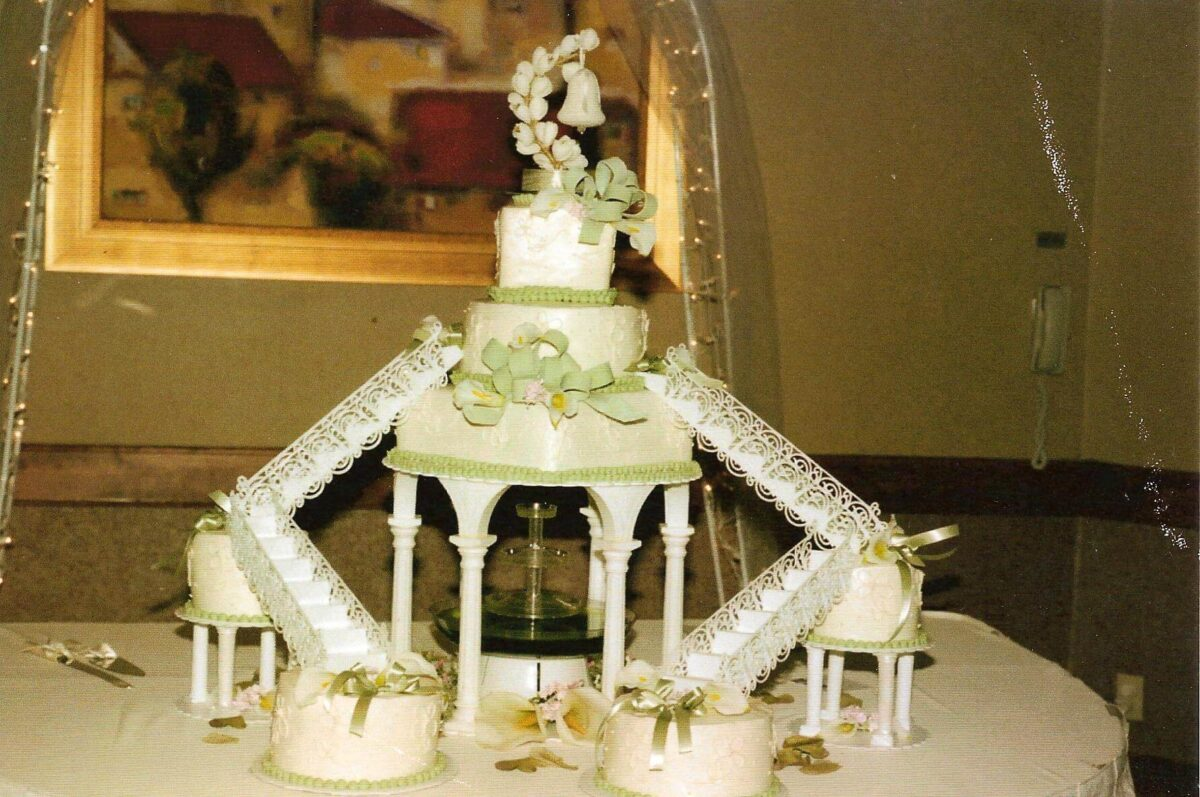 White Frosted Multi Cake Wedding Arrangement with Green Ribbons