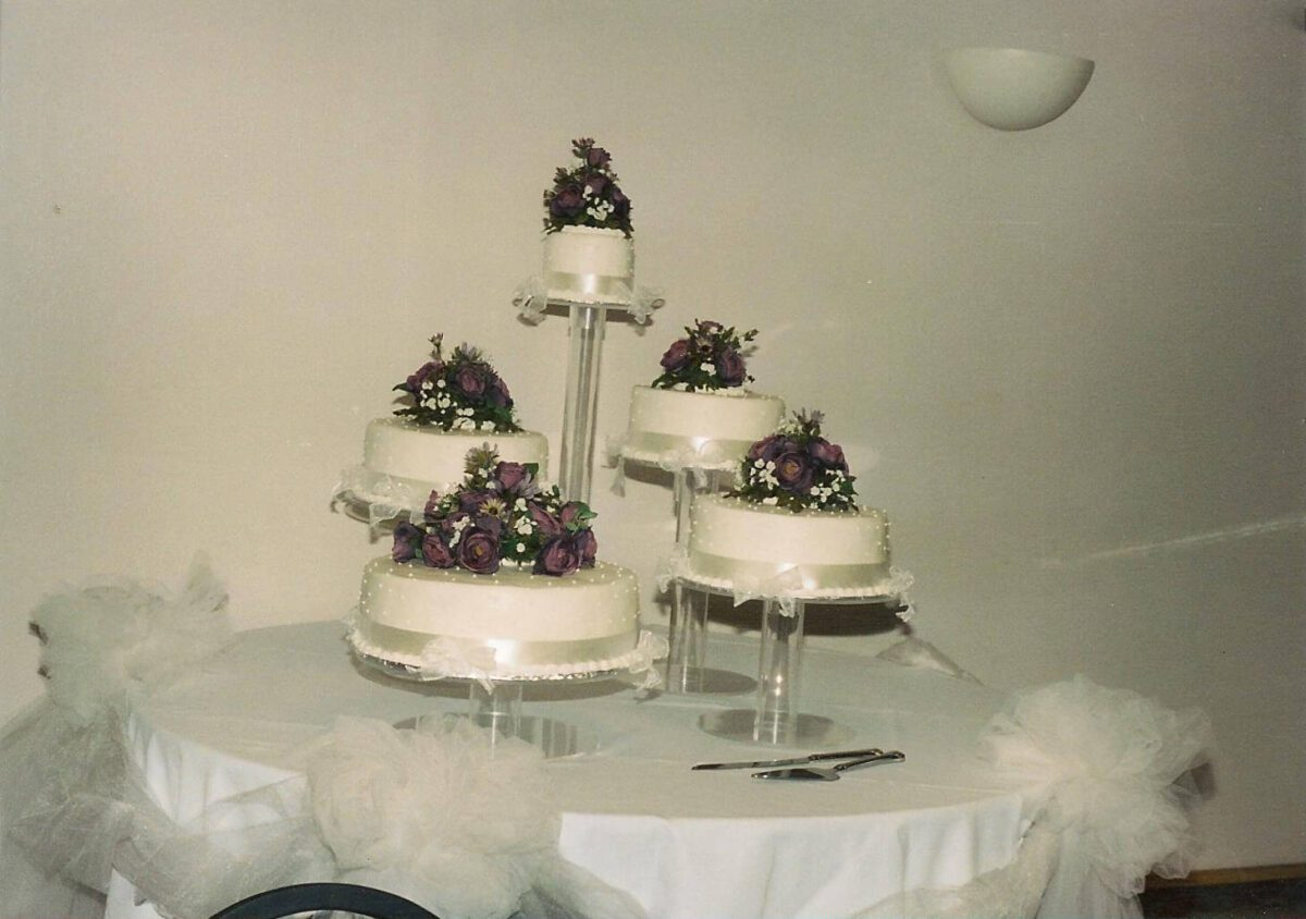 White Frosted Multi Cake Wedding Arrangement with Purple Flowers