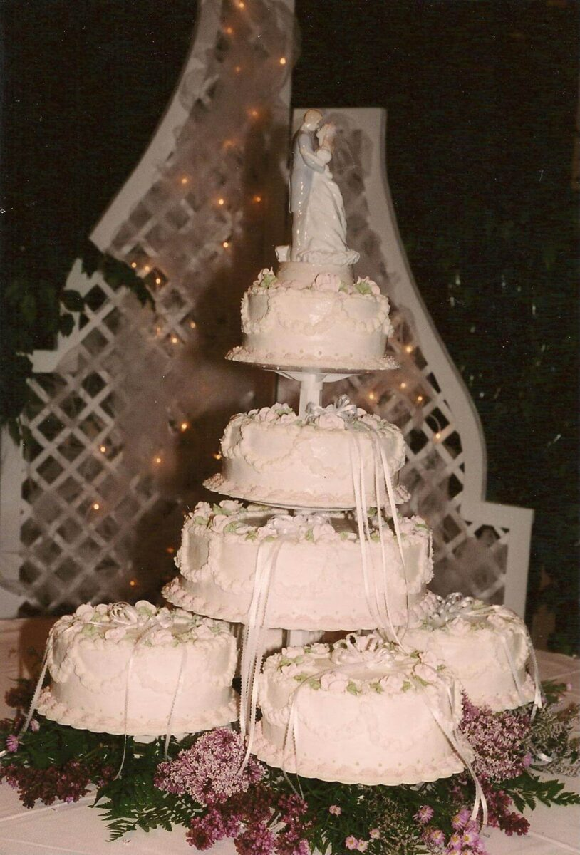 White Frosted Multi Cake Wedding Arrangement with White Ribbons
