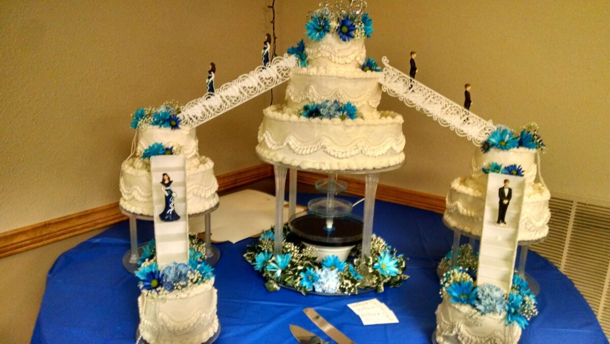 White Frosted Multi Cake Wedding Arrangement with Blue Flowers