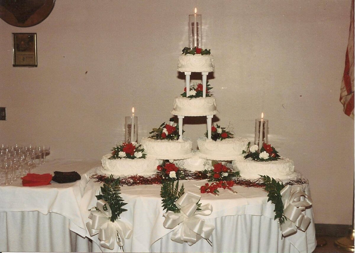 White Frosted Multi Cake Wedding Arrangement with White and Red Flowers