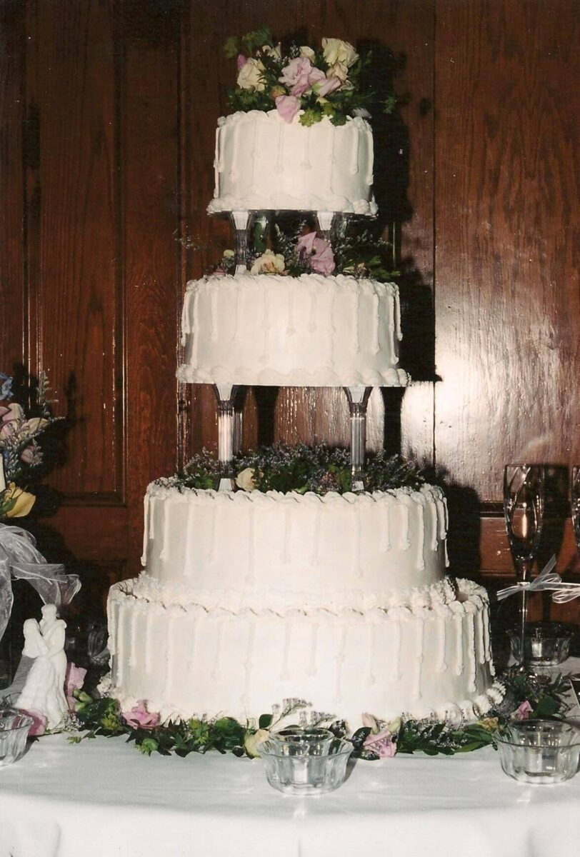 White Frosted 4 Tier Wedding Cake with Flowers