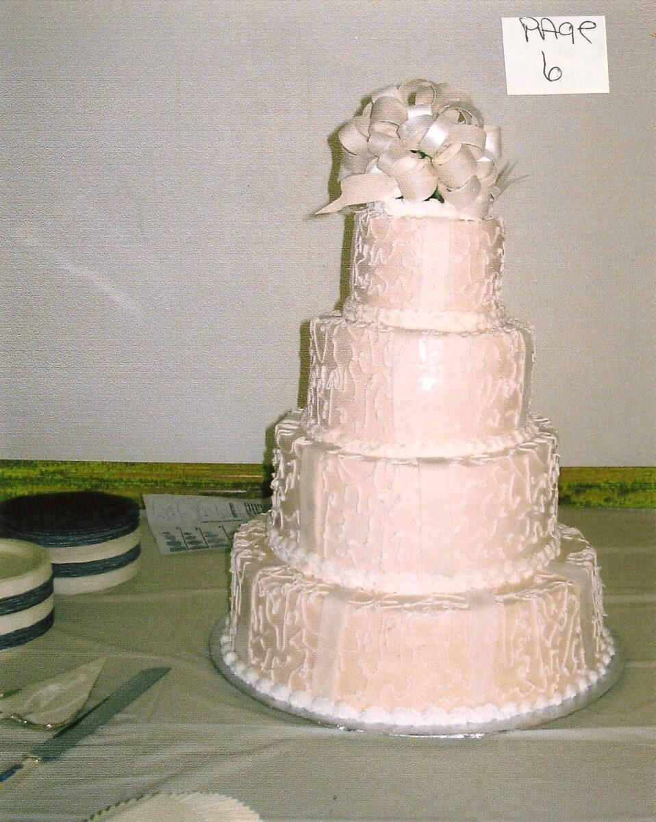 White Frosted 4 Tier Wedding Cake with White Ribbon