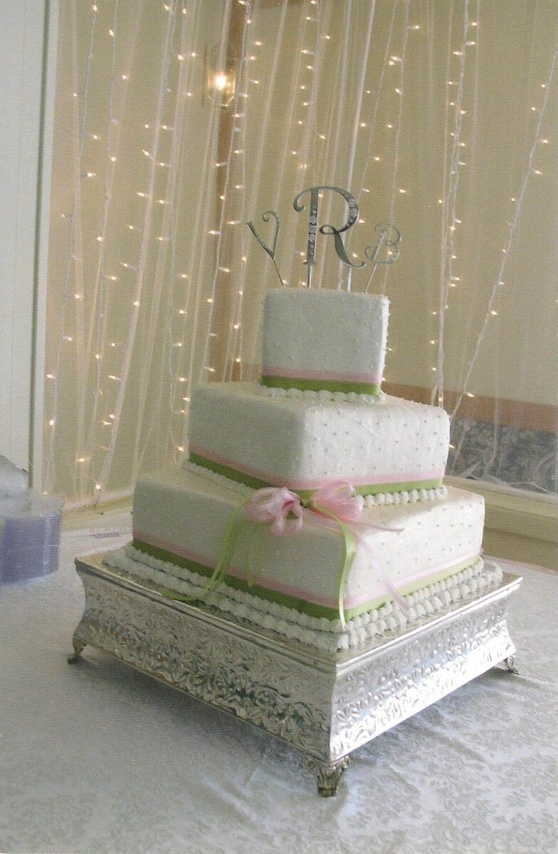White Frosted 3 Tier Wedding Cake with Pink and Green Ribbon