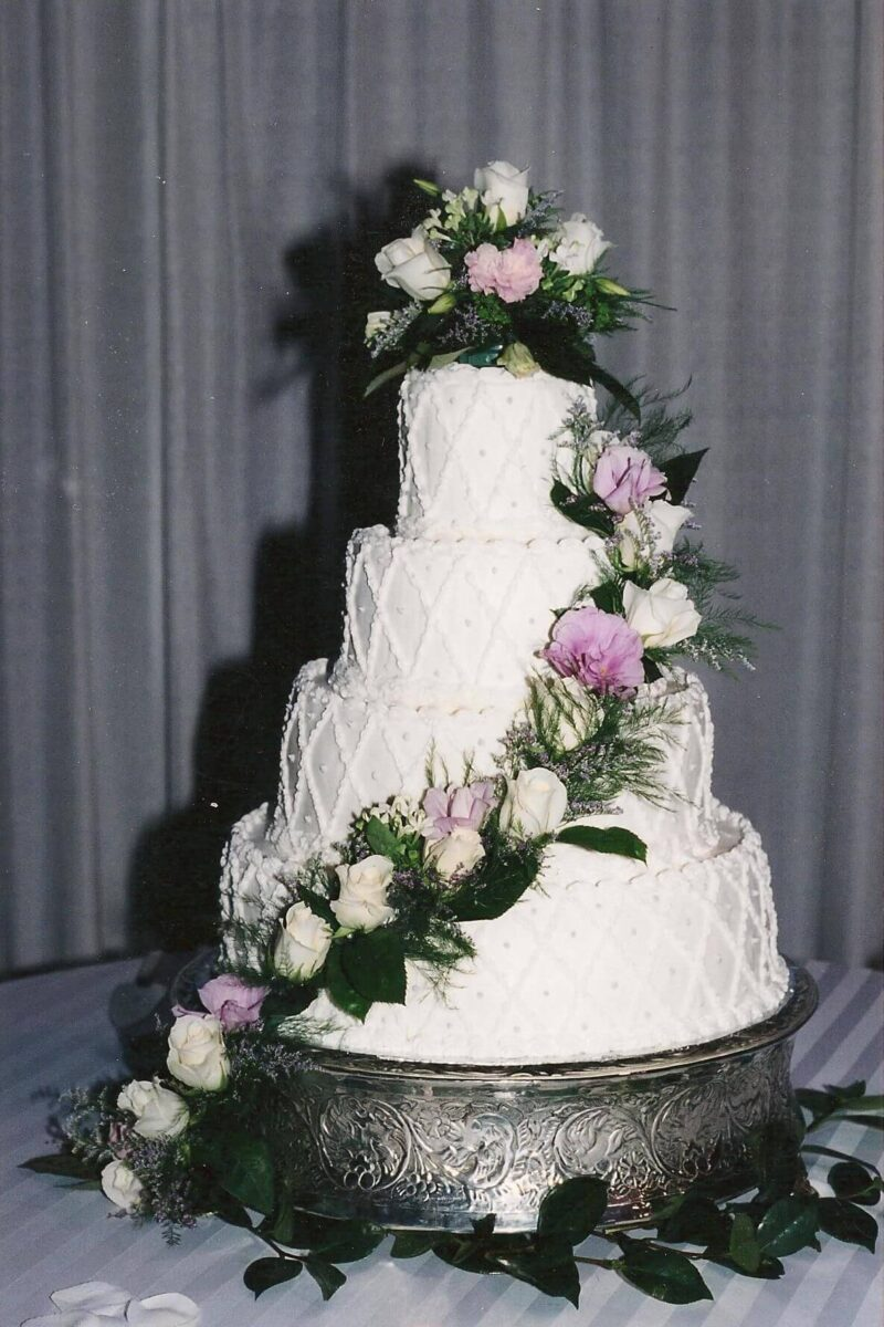 White Frosted 4 Tier Wedding Cake with Pink and White Flowers