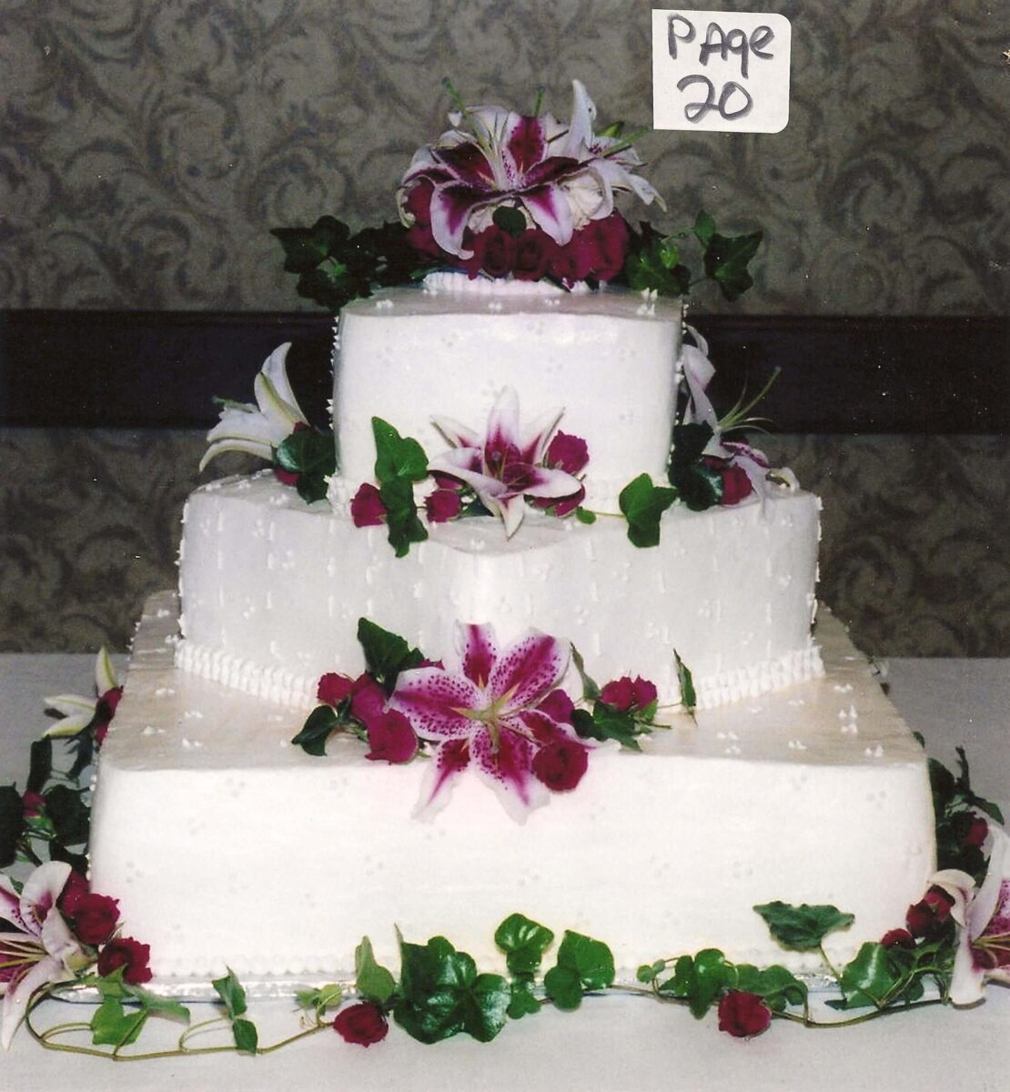 White Frosted 3 Tier Wedding Cake with Pink Lillies and Greenery
