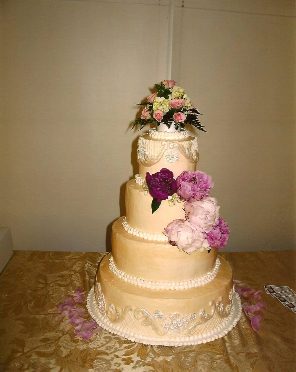 Gold and White Frosted 4 Tier Wedding Cake with Pink Peonies