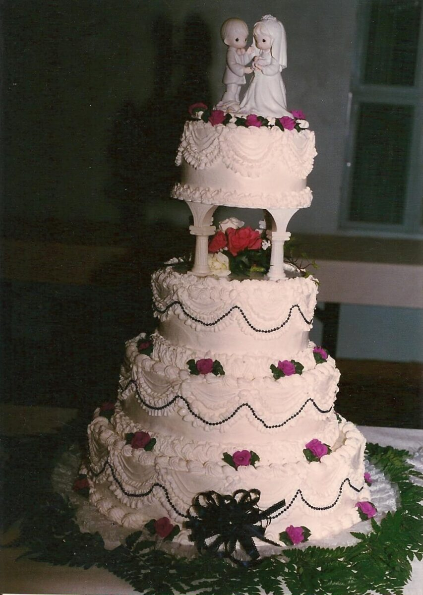 Black, Pink & White Frosted 4 Tier Wedding Cake with Flowers