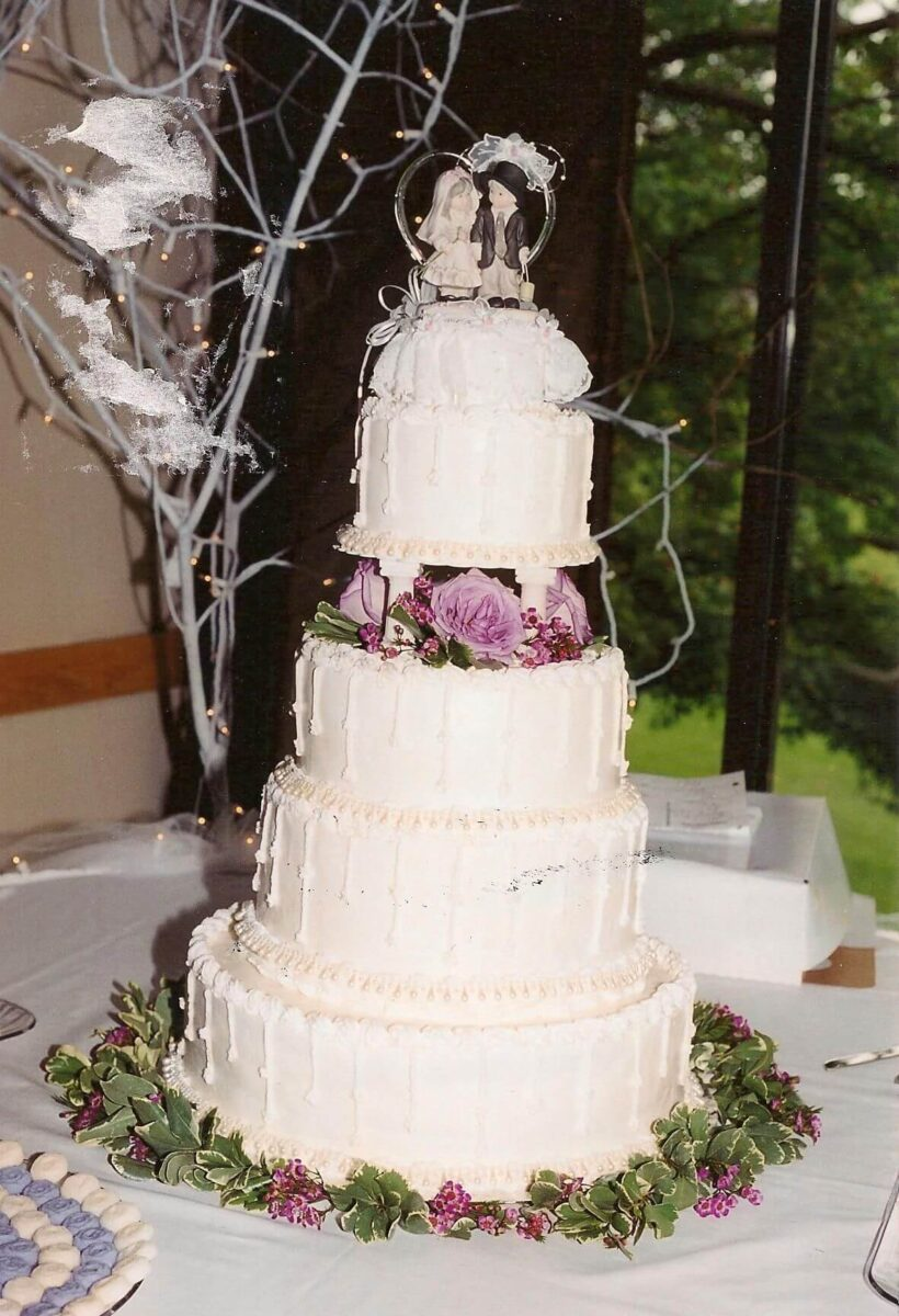White Frosted 5 Tier Wedding Cake with Pink Flowers