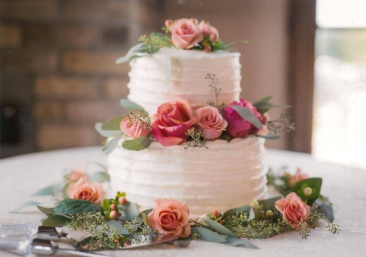 White Frosted 2 Tier Wedding Cake with Pink Roses and Greenery