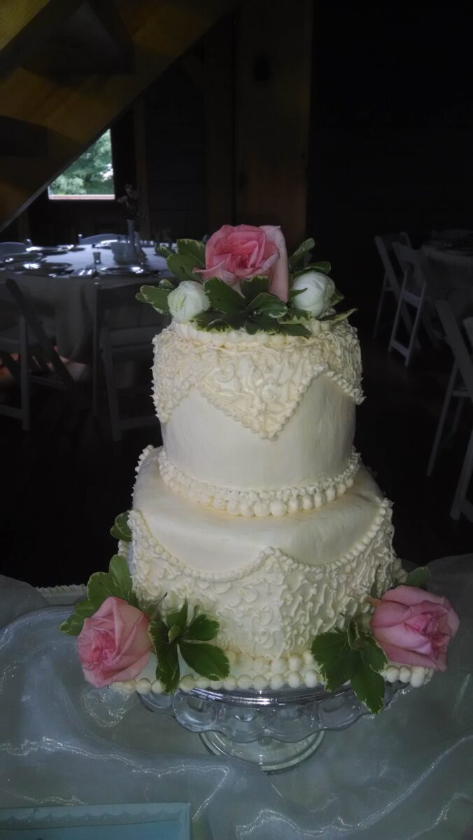 White Frosted 2 Tier Wedding Cake with Pink and White Flowers