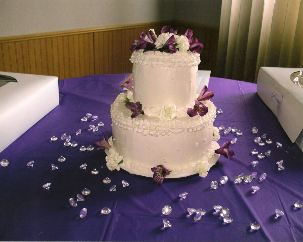 White Frosted 2 Tier Wedding Cake with White and Purple Flower