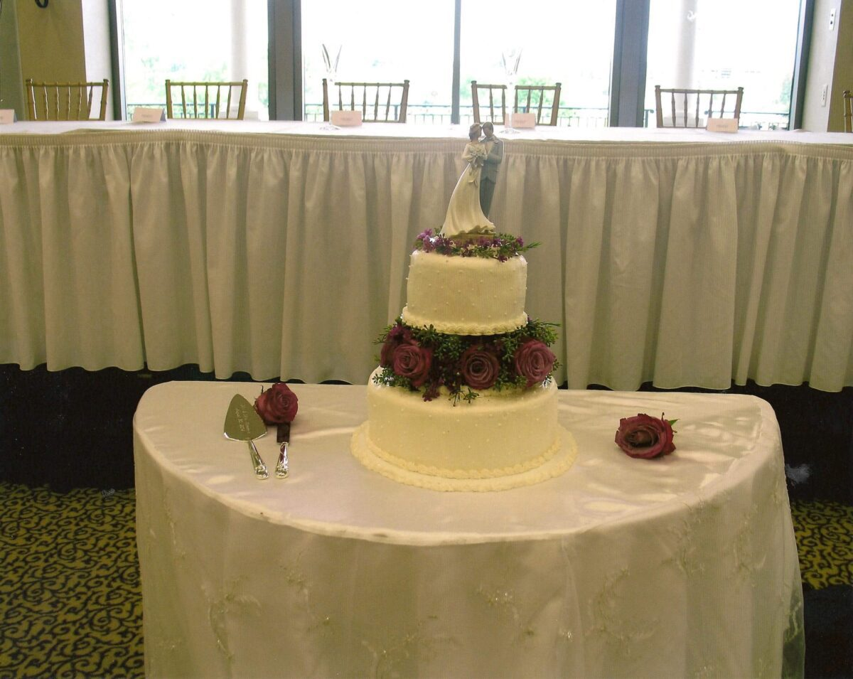 White Frosted 2 Tier Wedding Cake with Purple Roses