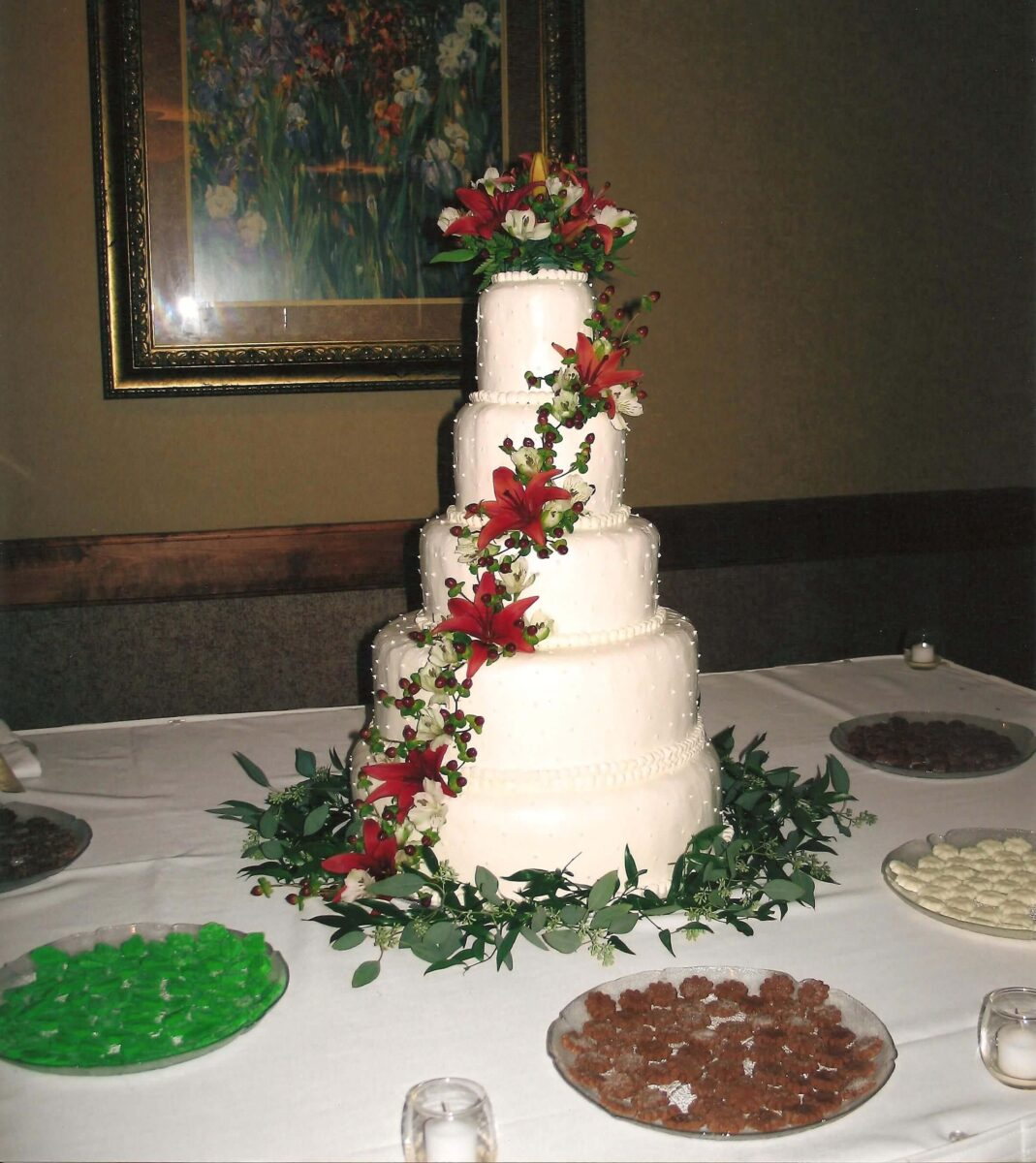 White Frosted 5 Tier Wedding Cake with Orange Lillies and Greenery