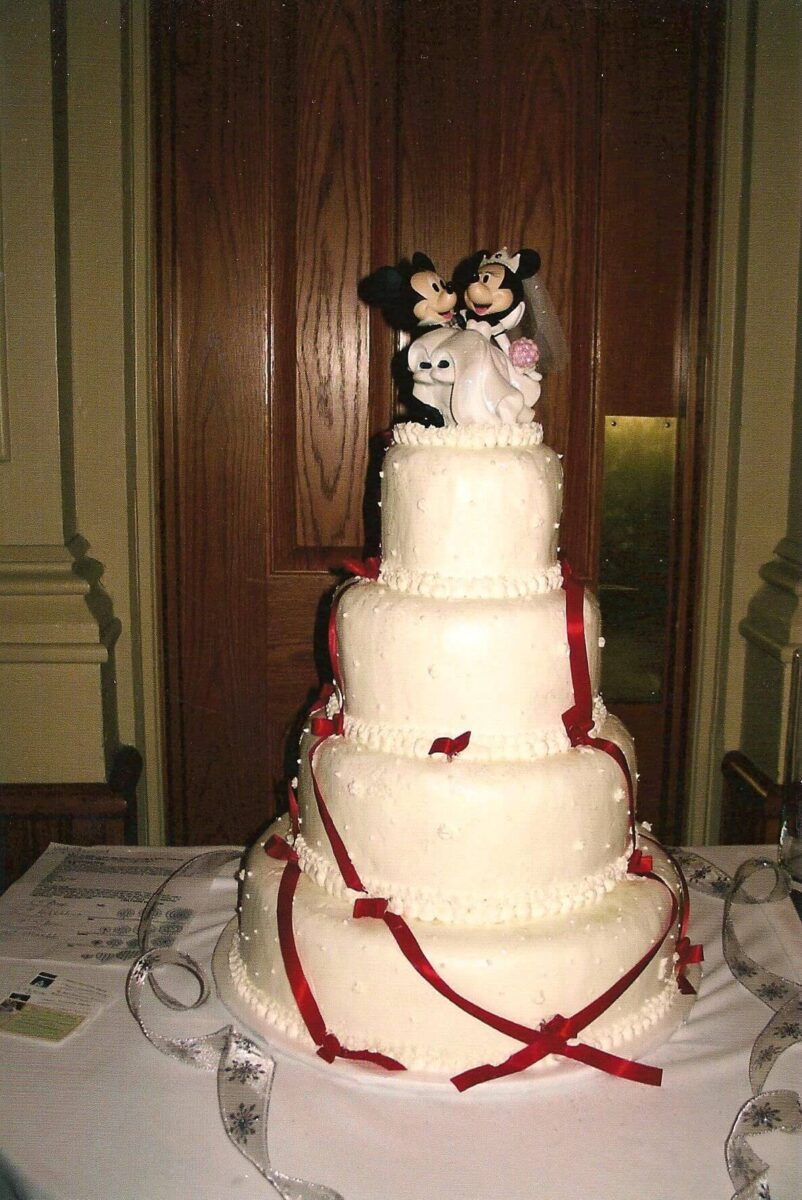 White Frosted 4 Tier Wedding Cake with Red Ribbon