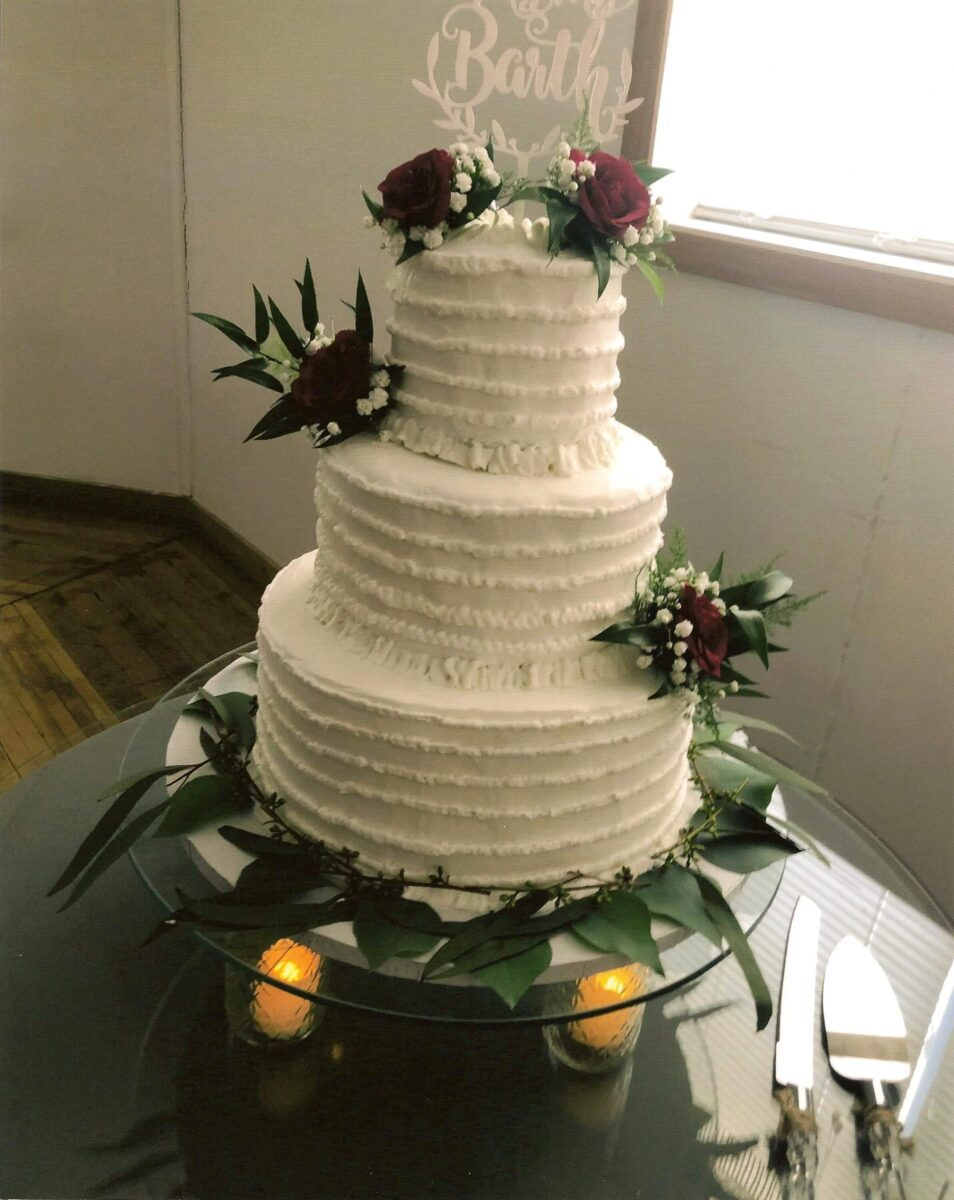 White Frosted 3 Tier Wedding Cake with Red Roses and Greenery