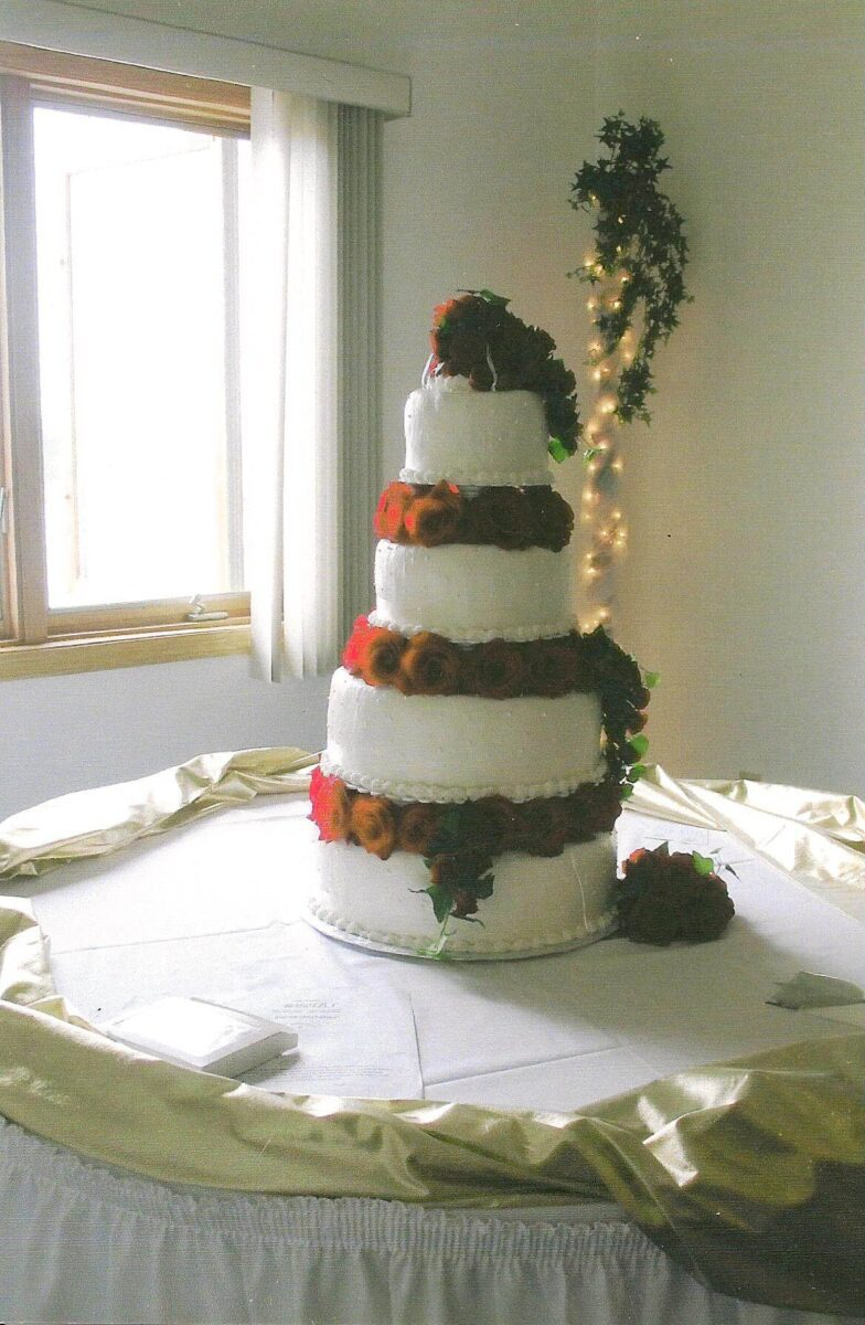 White Frosted 4 Tier Wedding Cake with Red Roses