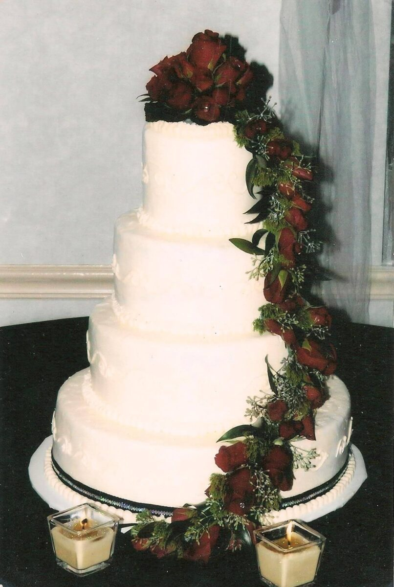 White Frosted 4 Tier Wedding Cake with Black Ribbon and Red Roses
