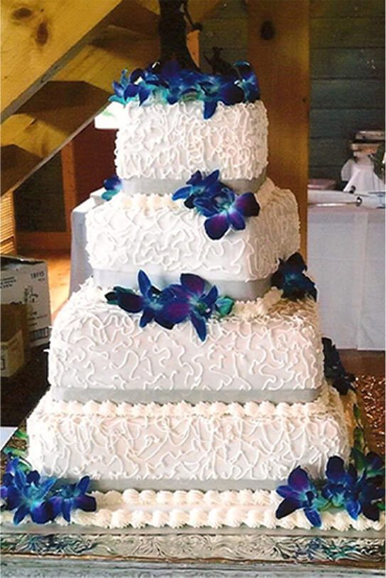 4 Tier Basket Weave Wedding Cake with Lighter Blue Accents
