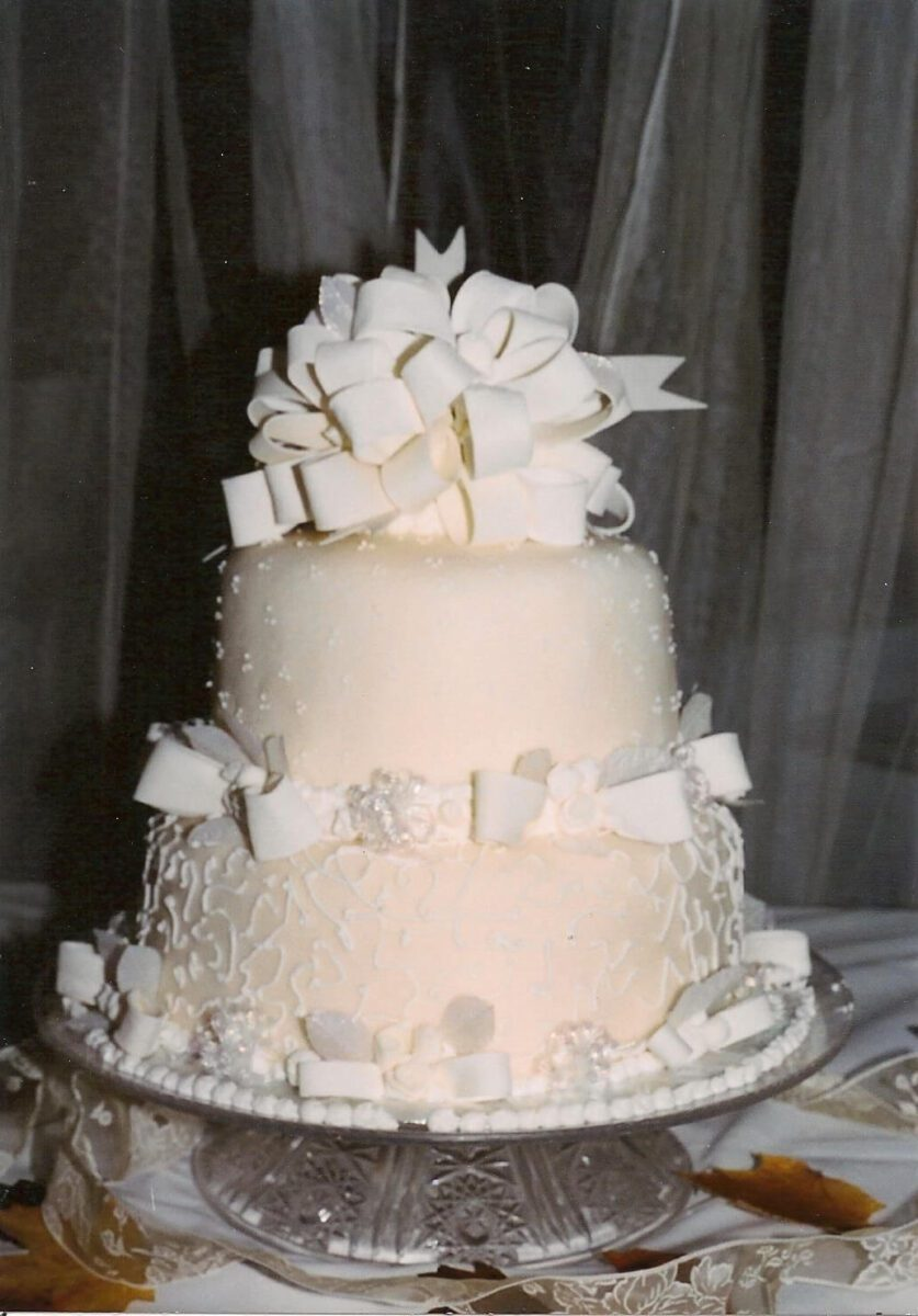 White Frosted 2 Tier Wedding Cake with White Ribbon