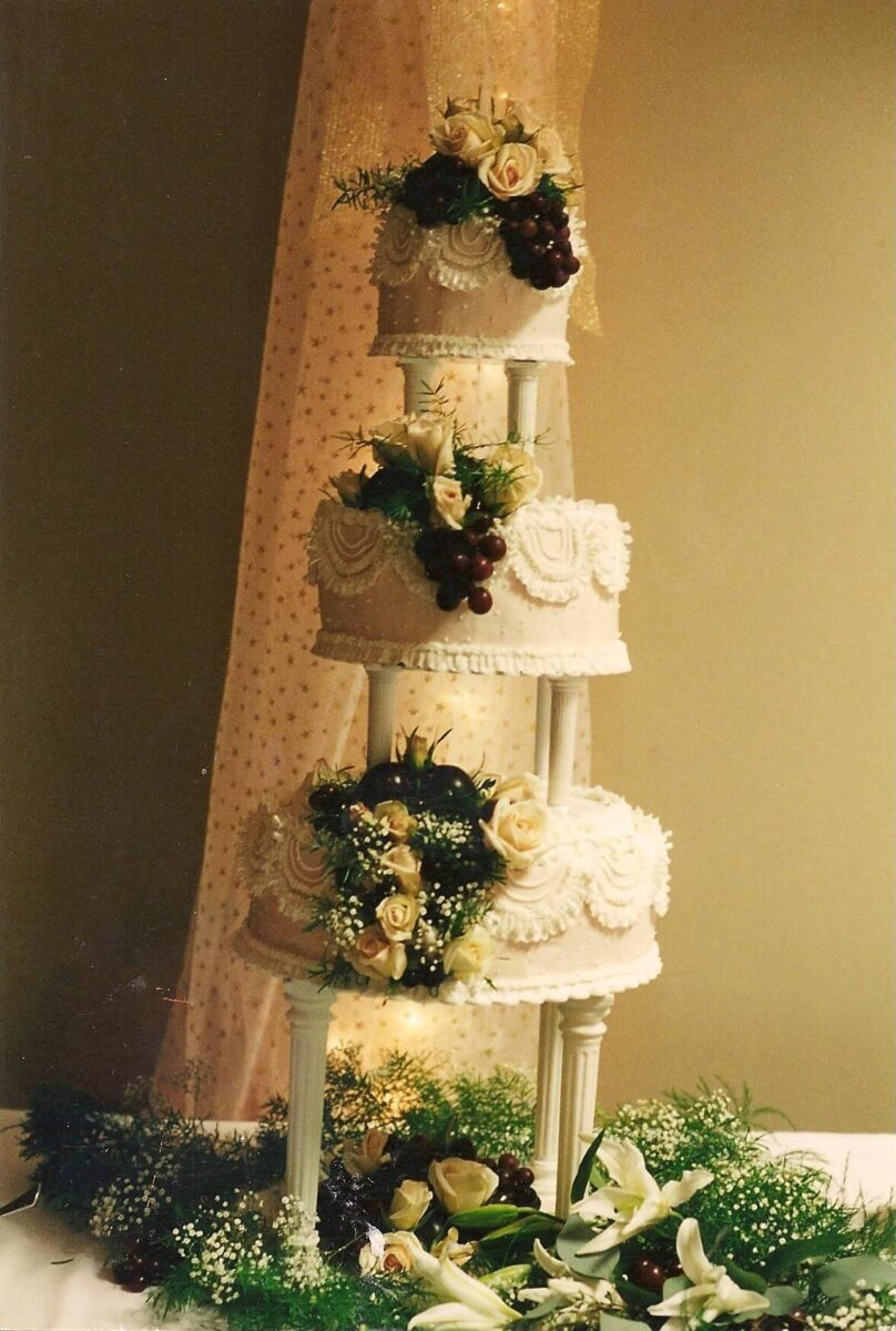 White Frosted 3 Tier Wedding Cake with White Roses